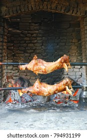 Whole lambs on skewer grilled in hot charcoal