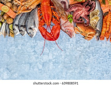 Whole lobster with seafood, crab, prawns, fish, salmon steak, octopus, oyster and other shells served on crushed ice.