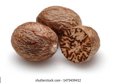 Whole nutmeg and half nutmeg isolated on white background