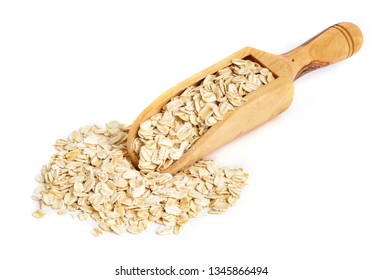 Whole oatmeal on wooden scoop with white background