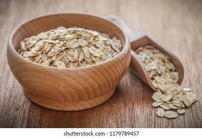 Whole oats closeup on textured natural surface