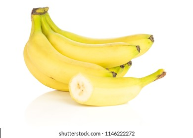 Lot of whole one half of fresh yellow banana isolated on white background
