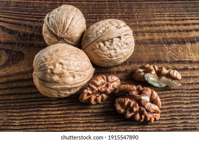 whole and open walnuts, walnut grain, on a wooden table
