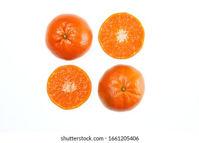A whole orange Mandarin and mandarin slices macro close up isolated on a white background