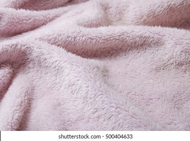 A whole page of pastel pink bath robe background texture