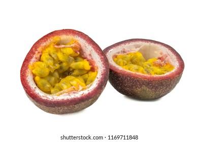 Whole passionfruit and a half maracuya fruit (Passiflora edulis) isolated on white background