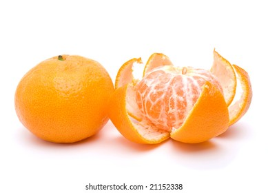 Whole and peeled tangerines isolated on the white background