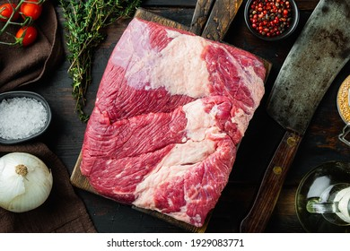 A whole piece of raw Beef Brisket set,with ingredients for smoking making barbecue, pastrami, cure, on old dark wooden table background, top view flat lay