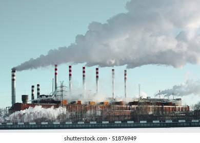 Whole plant with smoke and blue sky