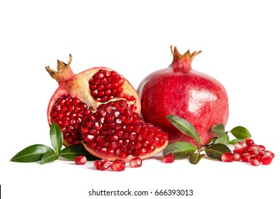 whole Pomegranate and two parts of Pomegranate with leaves and seeds isolated on white