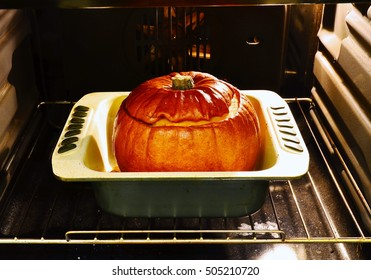 Whole pumpkin baked in the oven. Close up. Pumpkin  entirely baked in an oven. The whole baked orange pumpkin