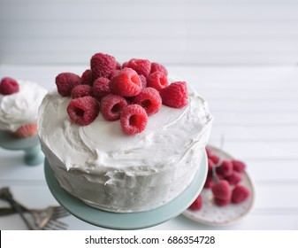 Whole raspberry cake on a white background.