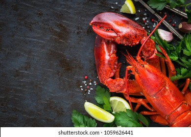Whole red lobster with fresh parsley, slices of lemon, garlic, salt and pepper beans. Overhead view with plenty of copy space for your text