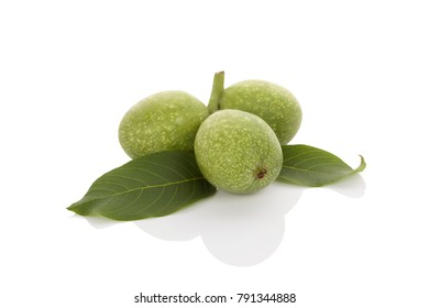 Whole ripe green wallnuts in nut shell isolated on white background.