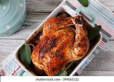 Whole roast chicken on grey background