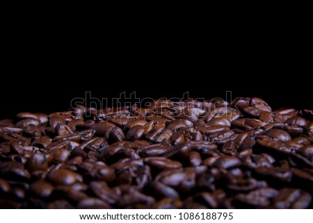 Whole roasted coffee beans with copy space