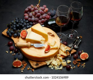 Whole round Head of parmesan or parmigiano hard cheese and wine