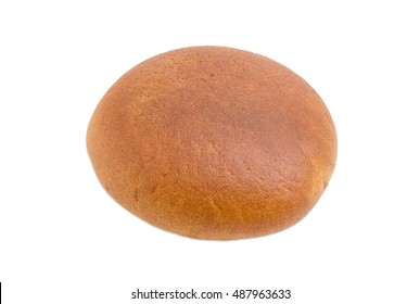 Whole round loaf of wheat and rye hearth bread on a light background