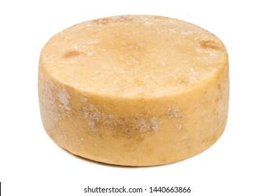 whole round partmesan or pecorino cheese head isolated on white