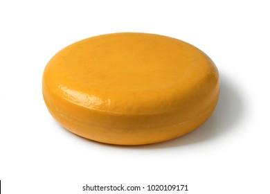 Whole round yellow Gouda cheese isolated on white background