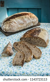 Whole rye and whole wheat sourdough bread  on a flowered table cloth