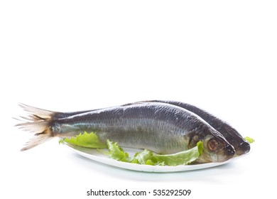 whole salted herring with lettuce