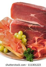 Whole serrano ham and slices.