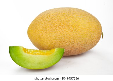 Whole and Slice of Canteloupe Melon