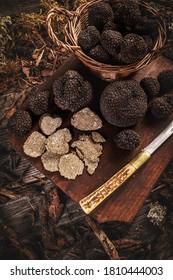 Whole and slice of delicacy black truffles mushroom