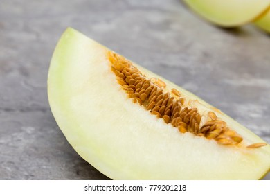 whole and slice of  melons, chopped with seeds