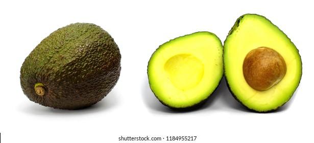 whole and sliced avocado fruit isolated on white background