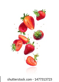 Whole and sliced fresh cherries in the air, isolated on a white background