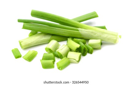 whole and sliced green spring onion on white background