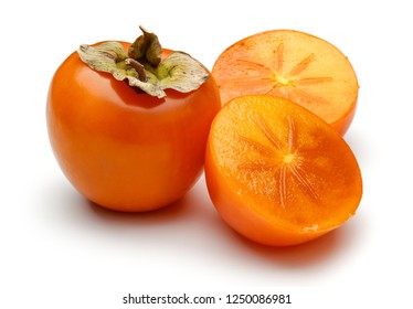 Whole and sliced persimmon fruit isolated on white background