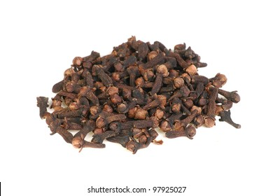 whole spice pile of whole cloves isolated on a white background