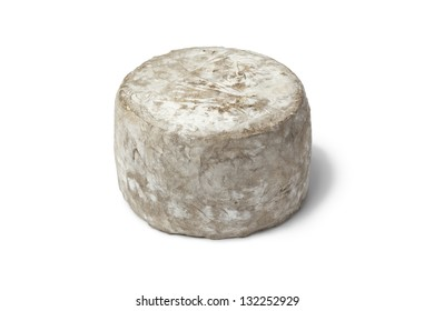 Whole Tommette de Yenne cheese made from cows milk on white background