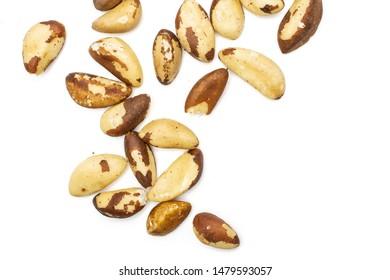 Lot of whole unshelled brazil nut flatlay isolated on white background
