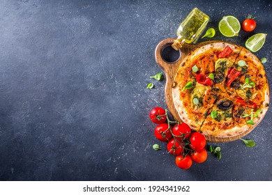 Whole Vegan Homemade pizza. Whole Grain Pizza with baked Vegetables and Mushrooms. grey stone background copy space
