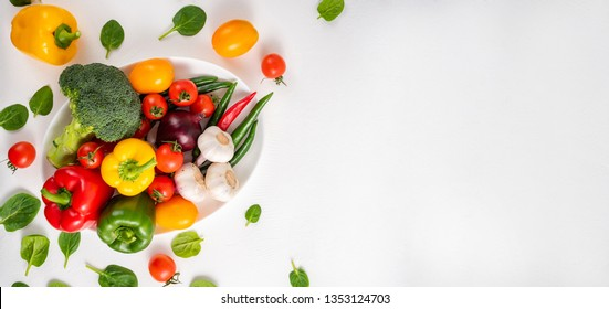 Whole vegetables on a white background, copy space. Banner
