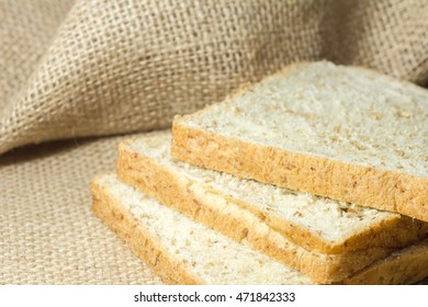 whole wheat bread  on the sack background