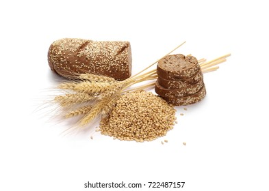 Whole wheat bread slices without additives, ears of wheat and grain isolated on white background