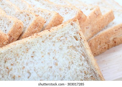 Whole wheat bread in a white background,Close up macro of a bread