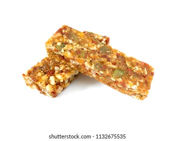 Whole wheat cereal bars or flapjacks with pumpkin seeds and dried fruit isolated on white background