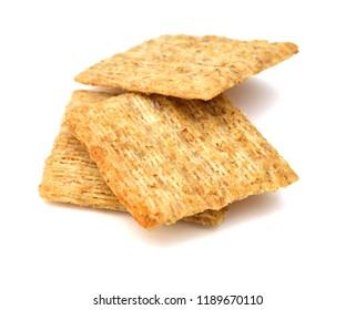 Whole wheat crackers on white background