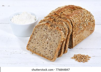 Whole wheat grain bread slice slices sliced loaf on wooden board wood