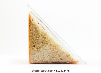 Whole wheat sandwich toast with ham and cheese in a plastic box isolated on white background