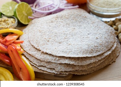 Whole wheat tortillas and fresh ingredients for Mexican cooking.