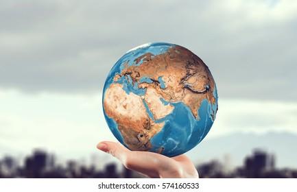 Whole world in hand . Mixed media