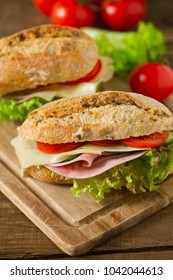 Wholegrain Ciabatta Sandwich with Lettuce, Tomatoes, Ham and Cheese