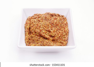wholegrain mustard in white dish